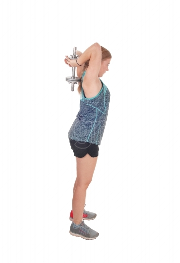 Young woman lifting dumbbell s over her head