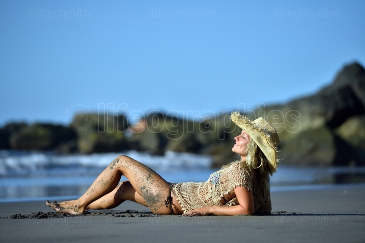 Young woman on the beach in summer vacation