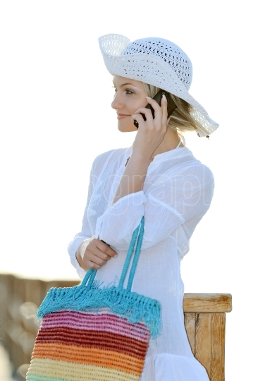Young woman outdoor in summer using cellphone