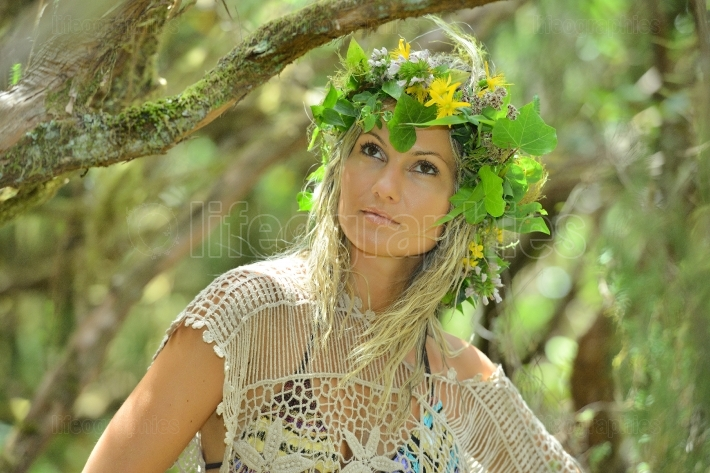Young woman portrait wearing wreath in summer