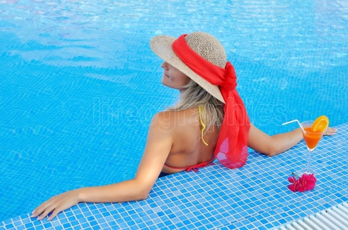 Young woman relaxing at the pool