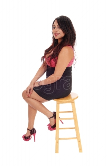 Young woman sitting on chair.