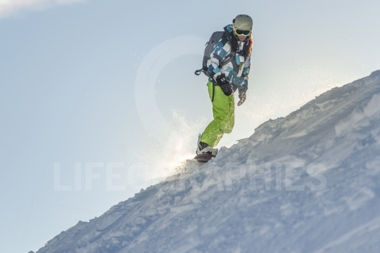 Young woman snowboarding