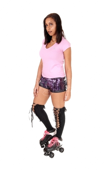 Young woman standing with her roller skates