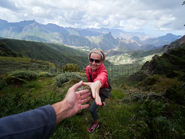 Young woman tourist in alpine zone in summer