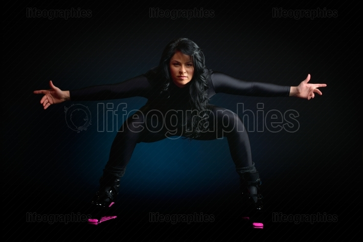 Young woman wearing kangoo jumps indoors