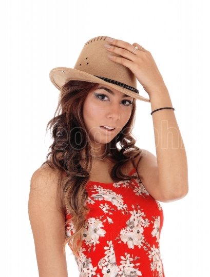 Young woman with a brown hat.