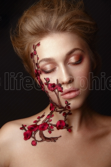 Young woman with flower makeup