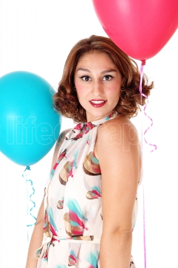 Young woman with two balloons.