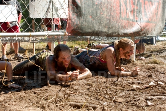Young Women Crawl Under Electrified Fence In 5K Obstacle Race