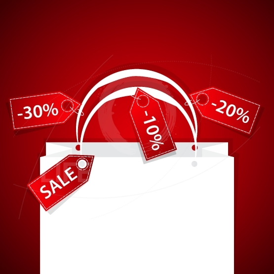 Paper shopping bag with discount labels and copy space background